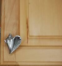 conch cabinet knob - right facing - installed