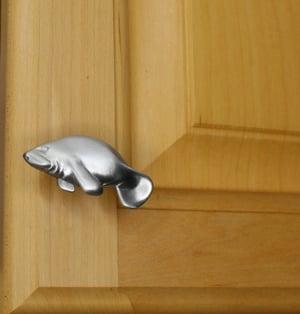 small manatee cabinet knob - left facing - installed on cabinet door