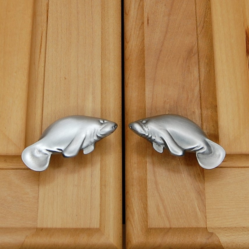 matching left and right manatee cabinet knobs