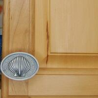 Scallop bezel cabinet knob horizontal